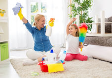 Cute mother and her daughter ready to cleaning room Royalty Free Stock Photography