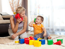 Cute mother and kid boy playing together. Indoor Royalty Free Stock Image