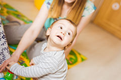 Cute mother and kid boy playing together indoor.  Stock Photos