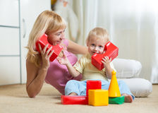 Cute mother and kid boy playing together indoor. Cute mother and kid boy role playing together indoor Stock Photography