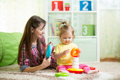 Cute mother and kid girl playing indoor at home Royalty Free Stock Photography