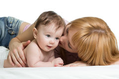 Cute mother kissing her little baby. Boy Stock Images