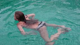 Cute mother with teenager daughter swimming in hotels pool having fun.  stock video footage