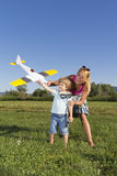 Cute mother, young son and RC plane Stock Photos
