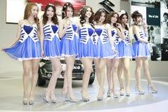 Cute Motor Pretty. Cute Pretty Models posts charmingly ahead Suzuki booth in Bangkok Motor Expo 2011 Impact Arena Muang Thong Thani, Thailand Stock Photo