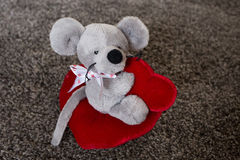 Cute mouse with heart pillow. Mouse toy. Stock Photos