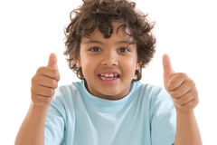 Cute mulatto boy  is showing a thumbs up to the camera. Royalty Free Stock Photography