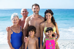 Cute multi generation family posing on the beach Stock Images