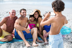 Cute multi generation family taking a picture. On the beach Royalty Free Stock Photography