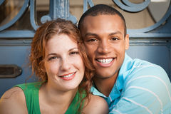 Cute multiracial couple. Hugging and smiling. Outdoors stock photos