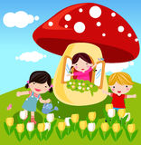 Cute mushrooms and kids Stock Photography