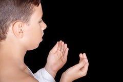 Cute Muslim Kid Praying While Wearing Ihram During Hajj Royalty Free Stock Photo