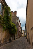Narrow Street. Cute narrow street in a small town in France Stock Photography