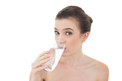 Cute natural brown haired model drinking water Stock Photography
