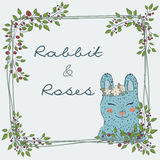Cute natural frame from branches of a rose with a blue rabbit. Collection of hand-drawn cute natural frame from branches of a rose with a blue rabbit. floral Stock Image