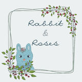 Cute natural frame from branches of a rose with a blue rabbit. Stock Images
