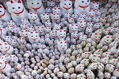 Cute neko charm statue inside Gotokuji temple. Neko temple in Tokyo, Japan stock images