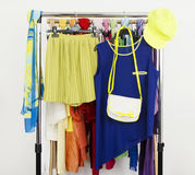Cute neon green and blue outfit displayed on a rack. Stock Image