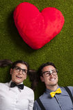 Cute nerd couple on grass Royalty Free Stock Photos