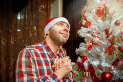 Cute nerd likes Christmas tree Royalty Free Stock Images