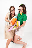 Cute nerdy girls bump into each other. Stock Photography