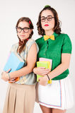 Cute nerdy girls holding books. Stock Photo