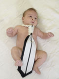 Cute new born baby wearing black and white tie Stock Images