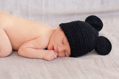 Cute newborn baby in black mouse hat Royalty Free Stock Image