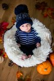 Cute newborn baby boy with knitted hat in a basket Royalty Free Stock Photo