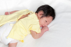 Cute newborn baby boy lie prone. On his bed Stock Photo