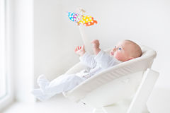 Free Cute Newborn Baby Boy Watching Colorful Mobile Toy Stock Images - 41566924