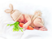 Cute newborn baby boy wearing knitted bunny costume Royalty Free Stock Photo