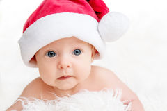 Cute newborn baby in christmas hat Royalty Free Stock Image