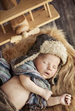Cute newborn baby dressed as a pilot Royalty Free Stock Images
