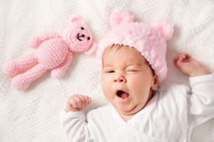 Cute newborn baby girl lying in the bed royalty free stock photos