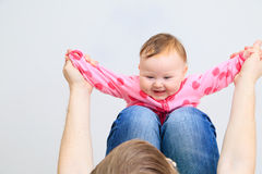 Cute newborn baby girl on parent lap Stock Images
