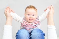 Cute newborn baby girl on parent lap Stock Photography