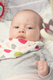 Cute newborn baby girl in a rocking seat Royalty Free Stock Photography
