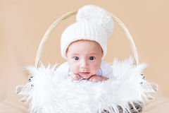 Cute newborn baby in knitted cap Royalty Free Stock Images