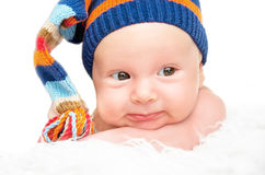 Cute newborn baby in knitted hat cap Royalty Free Stock Image