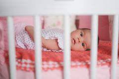 Cute newborn baby lying in bed Royalty Free Stock Images