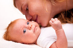 Cute newborn baby with mother Stock Photo