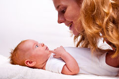 Cute newborn baby with mother Stock Photos