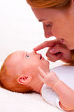 Cute newborn baby with mother Stock Images