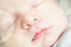 Cute newborn baby serie with pastel bokeh filter Royalty Free Stock Photo