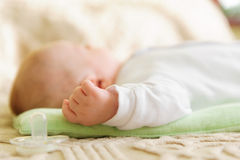Cute newborn baby sleeping in bed Royalty Free Stock Image