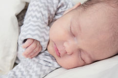 Cute newborn baby sleeping, one month old, face closeup stock photo