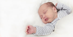 Cute newborn baby sleeping, one month old, with space for text royalty free stock photography