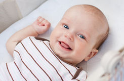Cute newborn baby. Smiling looking at the camera stock photos