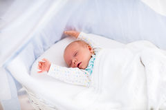 Cute newborn baby in white bed Royalty Free Stock Images